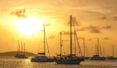 Moored sailboats in a St. Martin Harbor at sunset